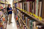 Kristen Bowdre Reading in the Library Shelves - 2