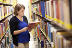 Kristen Bowdre Reading in the Library Shelves - 5