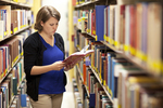 Kristen Bowdre Reading in the Library Shelves - 6