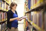 Kristen Bowdre Reading in the Library Shelves - 7
