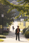 A Male and Female Student Walking on Campus