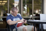 A Male Student Reading Outside the Library - 2