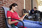 Laura Campbell Studying on the Library Porch