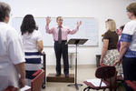 Dr. Bill Goold Directing a Singing Sems Rehearsal - 10