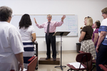 Dr. Bill Goold Directing a Singing Sems Rehearsal - 15