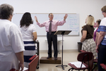 Dr. Bill Goold Directing a Singing Sems Rehearsal - 16