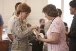 Karen Foldy Receiving Communion in Estes Chapel