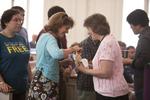 Dr. Ellen Marmon Receiving Communion in Estes Chapel - 2