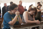 Erica Wellner and Leigh Krahl Kneeling in Estes Chapel - 2