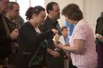 Heather Pillette Receiving Communion in Estes Chapel