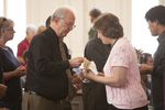 Dr. David Thompson Receiving Communion in Estes Chapel