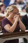 Cindy Schaap Kneeling in Estes Chapel