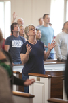 A Female Student Singing in Estes Chapel - 7