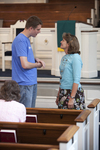 John Leek and Dr. Ellen Marmon Talking in Estes Chapel - 3