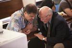 Mason Newman and Dr. Bob Stamps Kneeling in Estes Chapel - 2