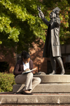 Mel Howard Reading by the Wesley Statue