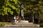 Mel Howard Reading by the Wesley Statue - 6