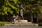Mel Howard Reading by the Wesley Statue - 8