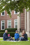 Curtis Elliott and Family in Front of the Admin Building - 6