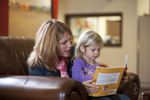 Margaret Elliott Reading to Her Daughter in the Student Center - 10