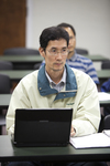 A Male Student Listening in Dr. Kima Pachuau's Class
