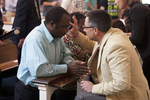 J.D. Walt Praying with Gideon Achi in Estes Chapel - 2