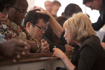 Peg Hutchins Praying with International Students in Estes Chapel - 3