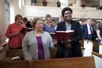 Shawnda Dykhoff and Dr. Anne Gatobu Singing in Estes Chapel