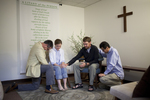 J.D. Walt Praying with Students in Carruth Prayer Chapel - 2