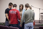 Carolyn Moore Praying with a Group of Young Men
