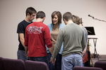 Carolyn Moore Praying with a Group of Young Men - 2