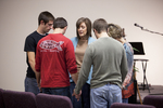 Carolyn Moore Praying with a Group of Young Men - 3
