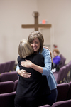 Carolyn Moore Hugging a Friend