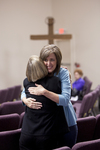 Carolyn Moore Hugging a Friend - 2
