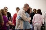 Carolyn Moore Hugging a Young Man
