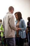 Carolyn Moore Praying with a Young Man - 4