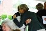 Julie Tennent Hugging Geneva Silvernail at the Kalas Village Dedication
