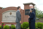 Dr. Tim Tennent with the Kalases by the Kalas Village Entrance