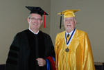 2011 Golden Graduate James Ogan with a 2011 Graduate