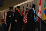 Kristen Schrickel Walking Across the Platform at the Spring 2011 Graduation