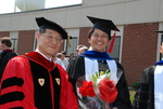 Dr. John Hong and a Student after the Spring 2011 Graduation