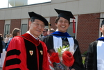 Dr. John Hong and a Student after the Spring 2011 Graduation - 2