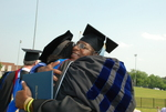 Monroe Parker Hugging Dr. Anne Gatobu after the Spring 2011 Graduation