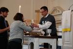 J.D. Walt Serving Communion to Sarah Jackson