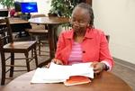 Medine Keener Reading a Journal - 5