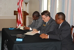 Dr. William Udotong, Dr. Tim Tennent, and Dr. Douglas Carew Signing Documents - 2