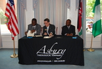 Dr. William Udotong, Dr. Tim Tennent, and Dr. Douglas Carew Signing Documents - 4