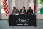 Dr. William Udotong, Dr. Tim Tennent, and Dr. Douglas Carew Signing Documents - 5