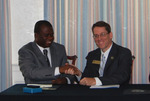 Dr. William Udotong Shaking Hands with Dr. Tim Tennent
