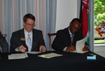 Dr. Tim Tennent and Dr. Douglas Carew Signing Documents
